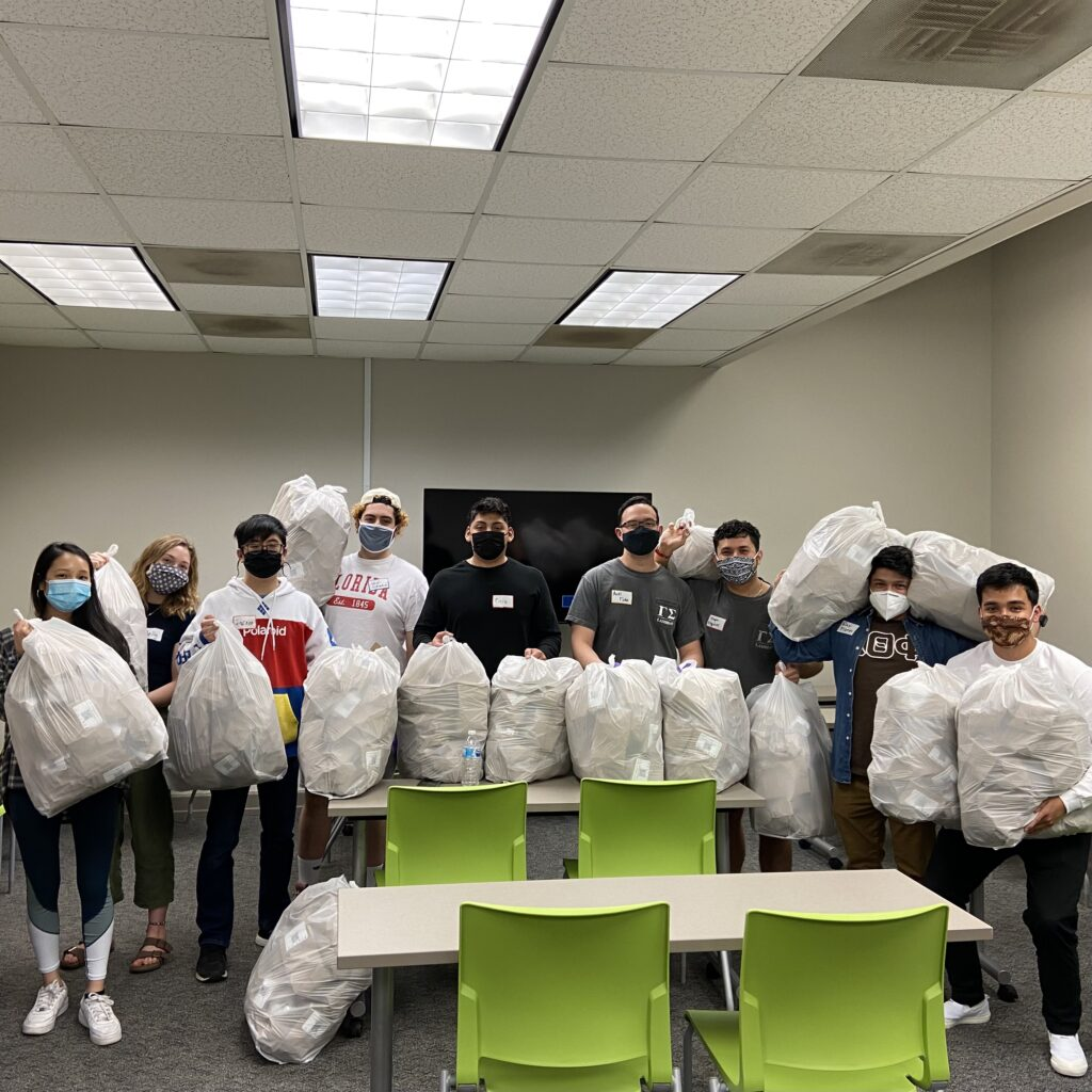 Students bag items for a service event.
