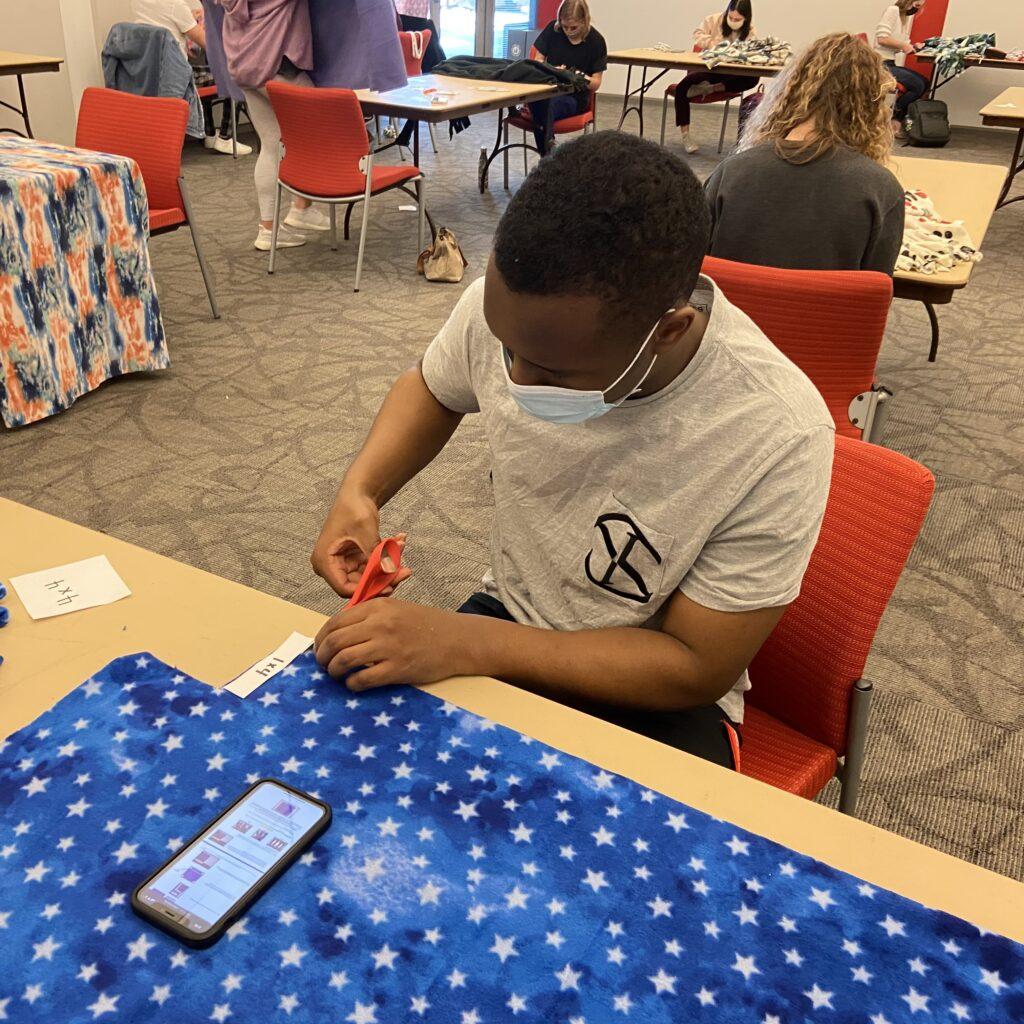 Student works on their blanket made for a service event called Project Linus in March 2021.