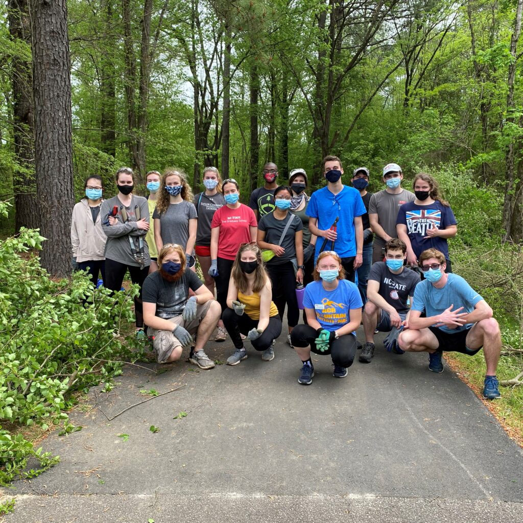 This picture shows a group of students engaging in a service project at the Walnut Creek Wetland Park in Raleigh in April 2021.